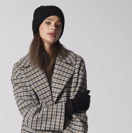 black beanie matched with checkered coat and black gloves for your first winter in canada